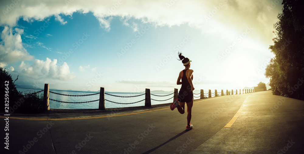Fototapety, obrazy: Fitness woman running on seaside trail in the morning