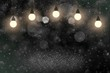 beautiful bright glitter lights defocused bokeh abstract background with light bulbs and falling snow flakes fly, festival mockup texture with blank space for your content