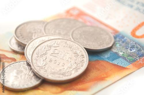 Valokuvatapetti Coins and bank note of Switzerland on white background