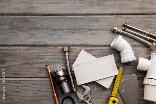 Plumbing tools and tiles. Home improvement background Canvas Print