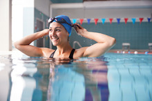 Female Swimmer Wearing Hat And...