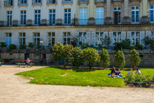People Rest On The Lawn On Le ...
