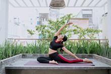 Young Woman Doing Yoga On Nature
