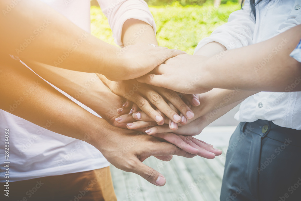 Fototapeta Team teamwork business join hand together concept. Power of male and female volunteer charity work. Success business startup