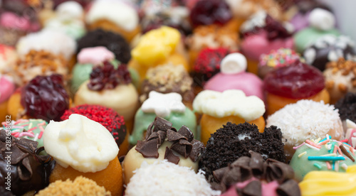 Delicious mini donuts with different glazes and toppings