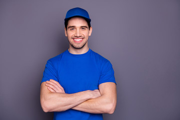 Close up photo express specialist he him his delivery boy strong arms crossed beaming smile self-confident person order offer customer wear blue t-shirt cap corporate suit isolated grey background