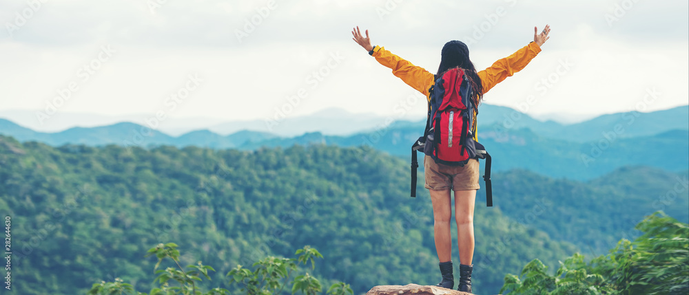Fototapety, obrazy: Women hiker or traveler with backpack adventure feeling victorious facing on the mountain, outdoor for education nature on vacation. Travel and Lifestyle Concept