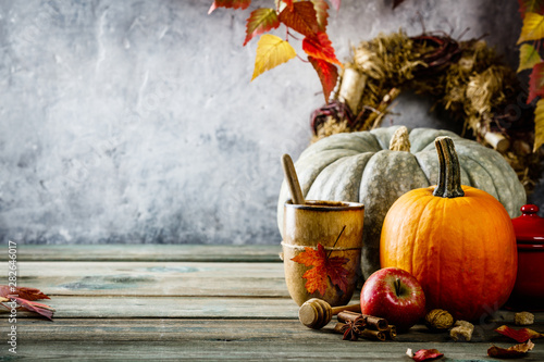 Autumn background on wooden tabel against old rust condition vintage wall - 282646017