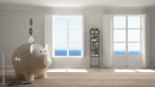 Fotografía  Wooden table top or shelf with white piggy bank with coins, stylish empty room w
