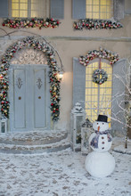 Porch Of The House With Christmas Decorations And Snowman
