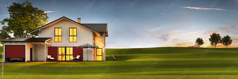 Fototapeta Evening view of a modern house with a lawn and a terrace.