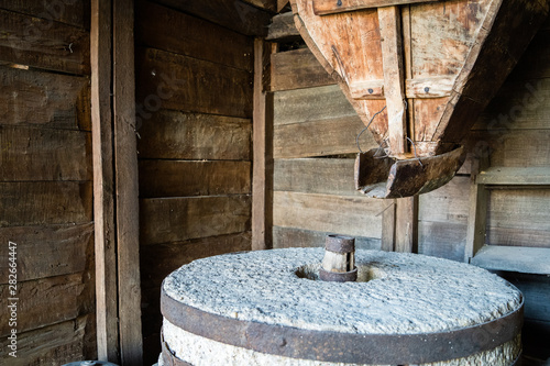 Valokuvatapetti The ancient old stone grain mill gristmill grinding wheat or grains into flour u