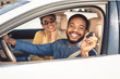 canvas print picture - Visiting car dealership. Afro couple showing car key