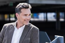 Portrait Of Businessman, Wearing Grey Suit Jacket