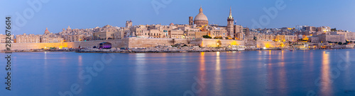 Obraz Valletta Panoramic view of the city and the bay at sunset. - fototapety do salonu