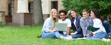Team Of Students Studying In Group Project Outdoors