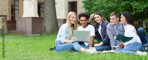 Obraz Team of students studying in group project outdoors - fototapety do salonu