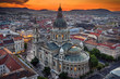 Budapest, Hungary - Aerial drone view of the beautiful St.Stephen's Basilica (Szent Istvan Bazilika) with a golden sunset. Parliament of Hungary and Fisherman's Bastion (Halaszbastya) at background