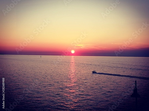 Red sunset with boat