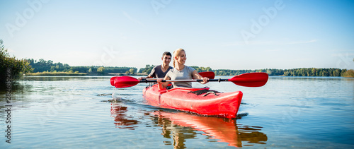 Fototapeta Happy couple kayaking on lake obraz
