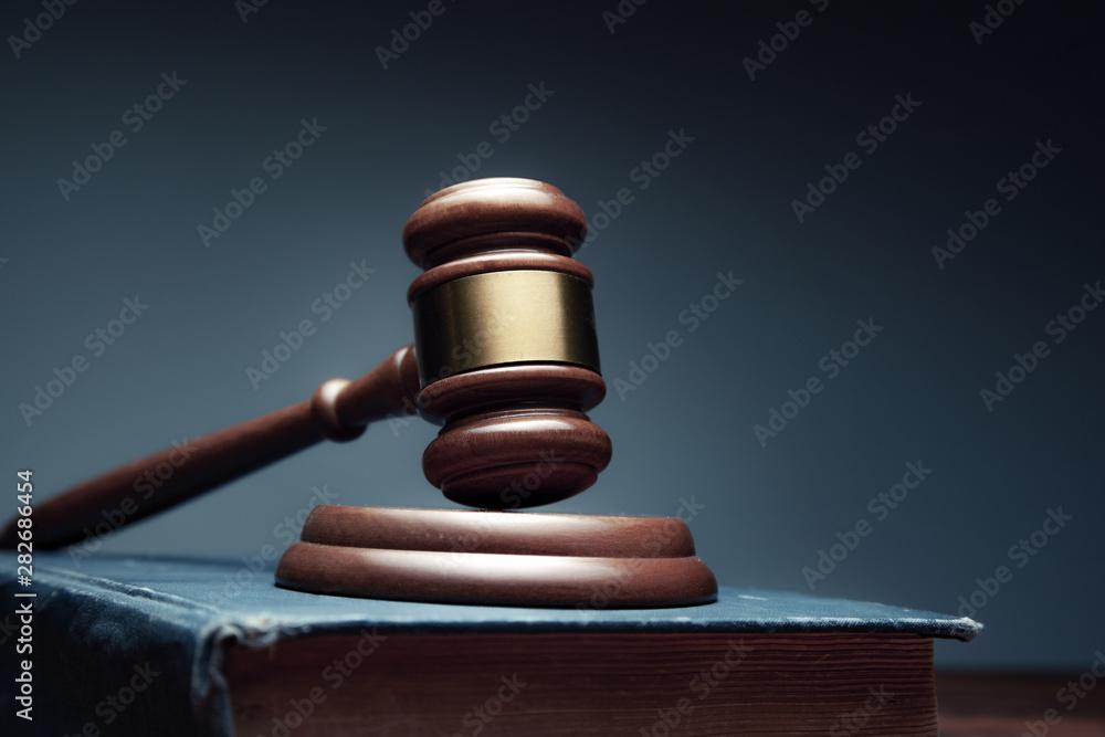 Fototapeta wooden judge on book on the desk