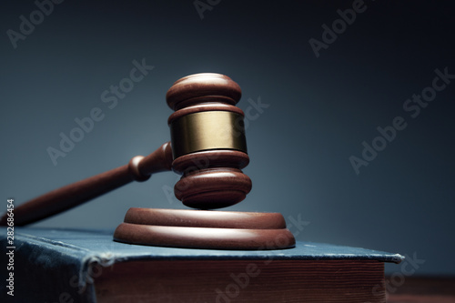 wooden judge on book on the desk Wallpaper Mural