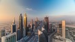 Skyline view of the buildings of Sheikh Zayed Road and DIFC aerial timelapse during sunset in Dubai, UAE. Modern towers and skyscrapers in financial center and downtown