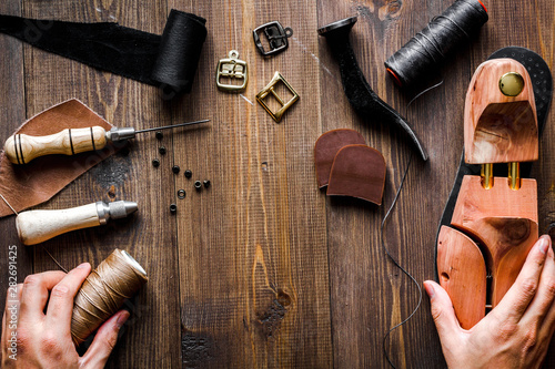 Canvas Prints Countryside cobbler tools in workshop dark background top view
