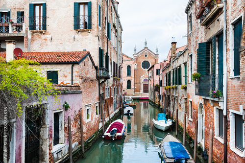 Scenic canal with old architecture in Venice, Italy. Famous travel destination