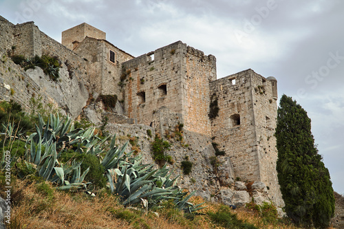 Stone walls of the medieval fortress Klis in Croatia. Canvas Print