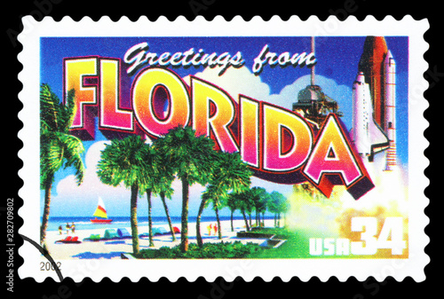 Fotografia  UNITED STATES OF AMERICA - CIRCA 2002: a postage stamp printed in USA showing an image of the Florida state, circa 2002