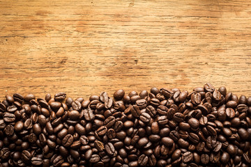 Fototapeta Kawa Roasted Coffee Beans on wood