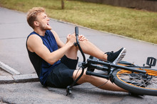 Sporty Young Man Fallen Off His Bicycle Outdoors