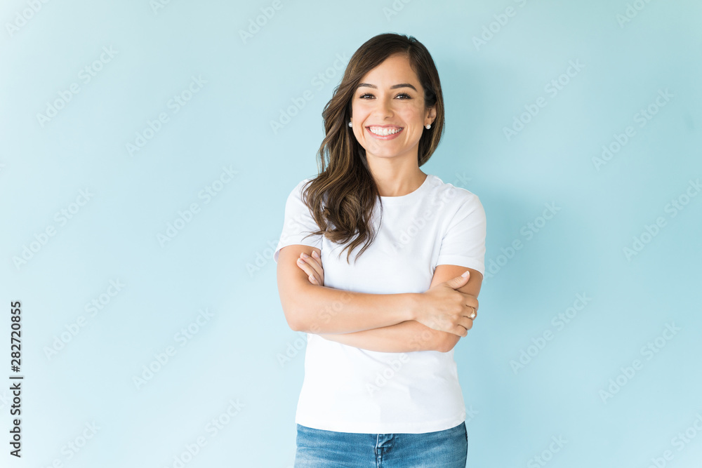 Fototapeta Confident Woman Over Isolated Background