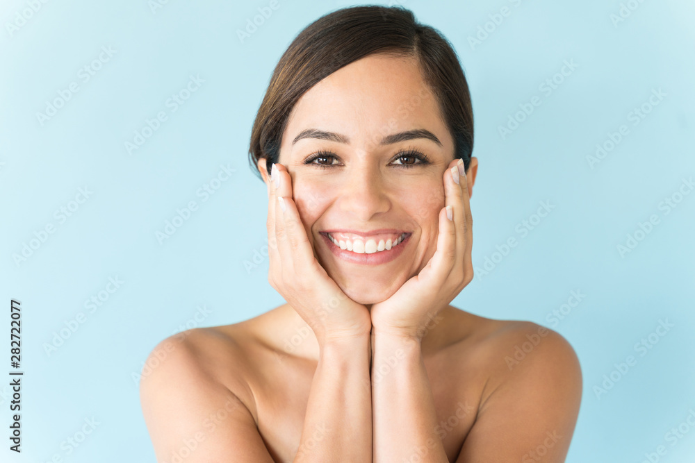 Fototapety, obrazy: Female With Hands On Face Against Plain Background