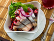 Leinwandbild Motiv Russian beetroot salad with herring
