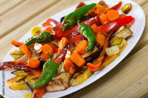 Photography of plate with plaque is baked vegetables