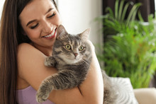 Young Woman With Cute Cat At Home, Space For Text. Pet And Owner