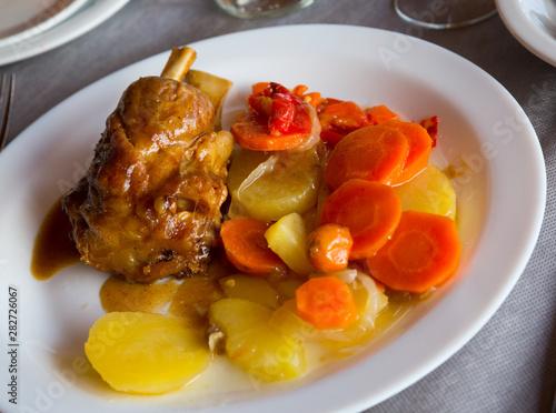 Codillo with baked potatoes