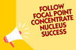 Text sign showing Follow Focal Point Concentrate Nucleus Success. Conceptual photo Concentration look for target Megaphone loudspeaker yellow background important message speaking loud