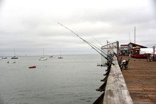 FIshing Poles On Pier Off California Coast