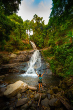 Girl In Victory Pose At The Huai Sai Luang Waterfall In Doi Inthanon National Park Near Chiang Mai Thailand