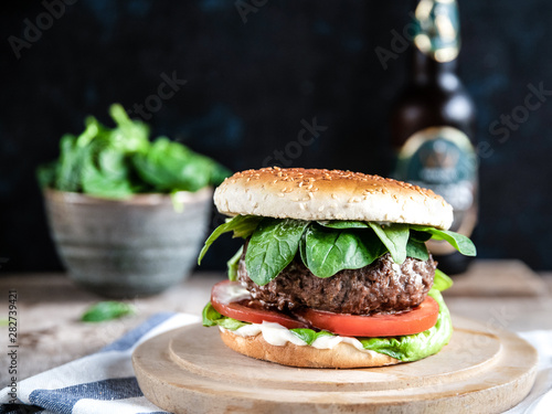 Leinwand Poster hamburger with leaves and beer bottle landscape image