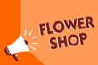 Conceptual hand writing showing Flower Shop. Business photo text where cut flowers are sold with decorations for gifts Megaphone loudspeaker orange background important message speaking