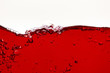 canvas print picture - red bright liquid with wave and bubbles isolated on white