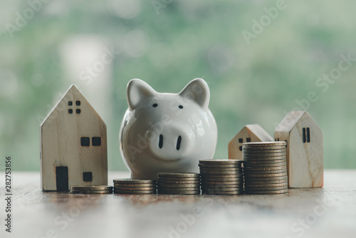 Obraz na plátně Concept of saving money to buy a house for the future.