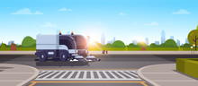 Modern City Street Sweeper Truck Washing Asphalt On Crossroad Industrial Vehicle Cleaning Machine Urban Road Service Concept Cityscape Sunset Background Flat Horizontal