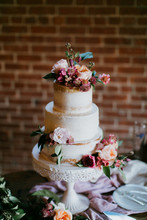 White Wedding Cake With Pink F...