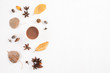 Leinwanddruck Bild - Autumn composition. Cup of coffee, autumn leaves on white wooden background. Flat lay, top view copy space.