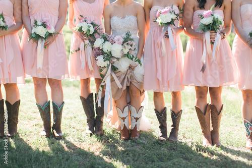 Bride and Bridesmaids wearing cowboy